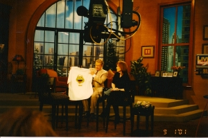 Regis Philbin and Meredith Viera on the set, holding up my Froggy 101 T-shirt